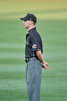 First base umpire Brett Terry handles the calls on the bases during the game between the Salt Lake Bees and the Nashville Sounds at Smith's Ballpark on July 27, 2018 in Salt Lake City, Utah. The Bees defeated the Sounds 8-6. (Stephen Smith/Four Seam Images)