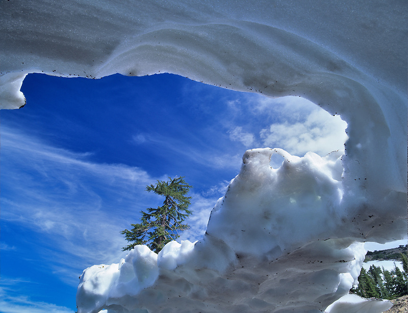 Snow cave carved by water. Mt. Lassen Volcanic National Park, California