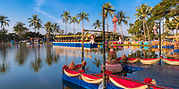 Colorful Loy Krathong festival decorations and lamp reflections on the lake on a sunny day in famous Sukhothai Historical Park, Thailand
