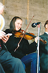 Ciara Brennan playing in a session in O'Connell Square, Ennis, during the Fleadh Nua - June 4, 1999. Photograph by John Kelly