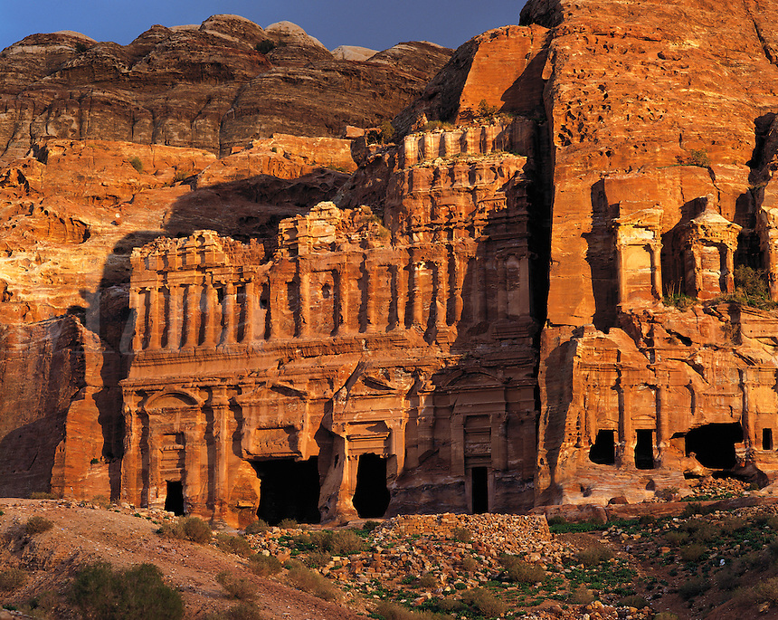 """Warm evening light on the """"Royal"""" tombs carved into the rock-walls of Petra, Jorda"""