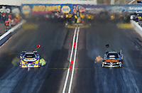 Feb. 24, 2013; Chandler, AZ, USA; NHRA funny car driver Ron Capps (left) races alongside Tony Pedregon during the Arizona Nationals at Firebird International Raceway. Mandatory Credit: Mark J. Rebilas-