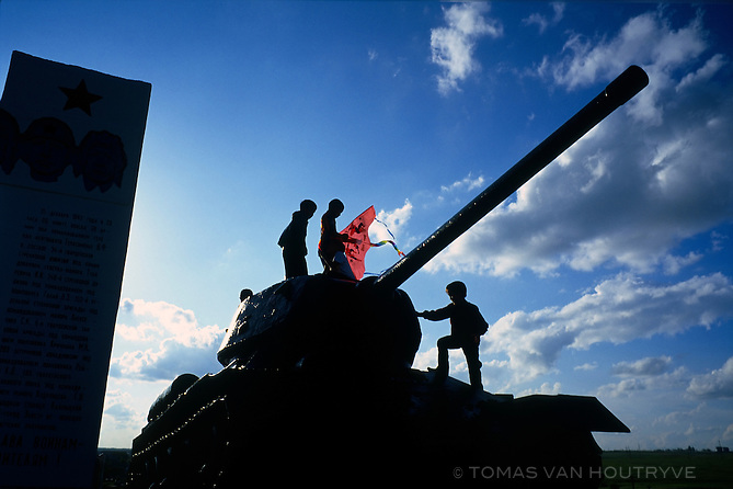 Boys with a kite play on a monument of an old Soviet Red Army tank at the entrance of Elista, Republic of Kalmykia, Russian Federation in May 12, 2010.