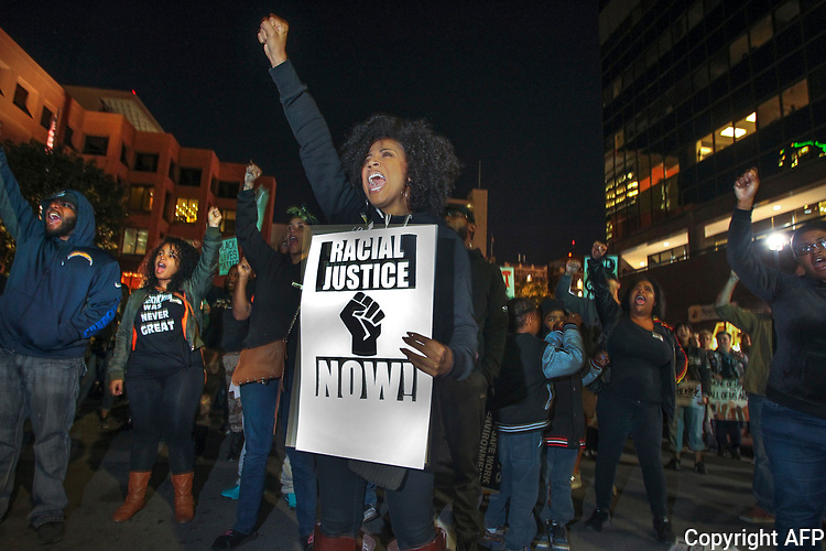 A demonstration representing several different causes; police shootings, global warming, low wages and opposition to the Dakota Access Pipeline, to name several examples, attracted more than one thousand people who marched through the streets of San Diego November 29, 2016.