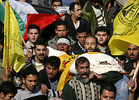"Gaza.17.01.2008Palestinians carry the body of Mohammed Safadi, a militant from the violent group the Popular Resistance Committees, during his funeral in Gaza City, Thursday, Jan. 17, 2008. Safadi was killed Wednesday in an Israeli airstrike.""photo by Fady Adwan"