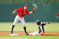 Kannapolis Intimidators second baseman Eric Grabe (18) waits for the throw as Nick Urbanus (4) of the Hickory Crawdads steals second base at CMC-Northeast Stadium on July 28, 2013 in Kannapolis, North Carolina.  The Crawdads defeated the Intimidators 6-1.  (Brian Westerholt/Four Seam Images)