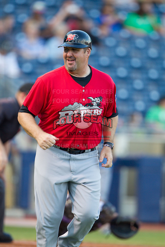 Frisco RoughRiders coach James Vilade heads to first base during the Texas League game against the Tulsa Drillers at ONEOK field on August 15, 2014 in Tulsa, Oklahoma  The RoughRiders defeated the Drillers 8-2.  (William Purnell/Four Seam Images)