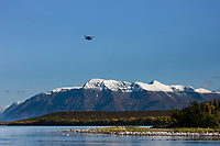 Float plane flies over Mount Katolinat and Naknek lake, Katmai National Park, Alaska.