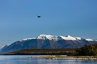 Float plane flies over Mount Katolinat and Naknek lake, Katmai National Park, Alaska.