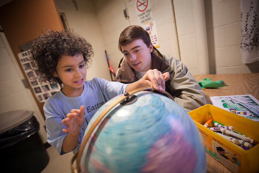 EASTON, PA FEBRUARY 18:  KIC students ( Kids in the Community, a program sponsored by the Landis Outreach Center  visited the  children of  Jefferson Street public housing . Here English major J.J. Houldin and Myssa Parker point out city on a Globe