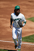 Beloit Snappers right fielder JaVon Shelby (5) jogs back to the dugout during a game against the Bowling Green Hot Rods on May 7, 2017 at Pohlman Field in Beloit, Wisconsin.  Bowling Green defeated Beloit 6-2.  (Mike Janes/Four Seam Images)