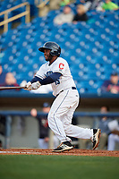 Lake County Captains first baseman Jose Vicente (15) follows through on a swing during the first game of a doubleheader against the South Bend Cubs on May 16, 2018 at Classic Park in Eastlake, Ohio.  South Bend defeated Lake County 6-4 in twelve innings.  (Mike Janes/Four Seam Images)