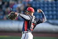 Right fielder Justin Dean (5) of the Rome Braves warms up before a game against the Greenville Drive on Friday, April 19, 2019, at Fluor Field at the West End in Greenville, South Carolina. Greenville won, 2-0. (Tom Priddy/Four Seam Images)