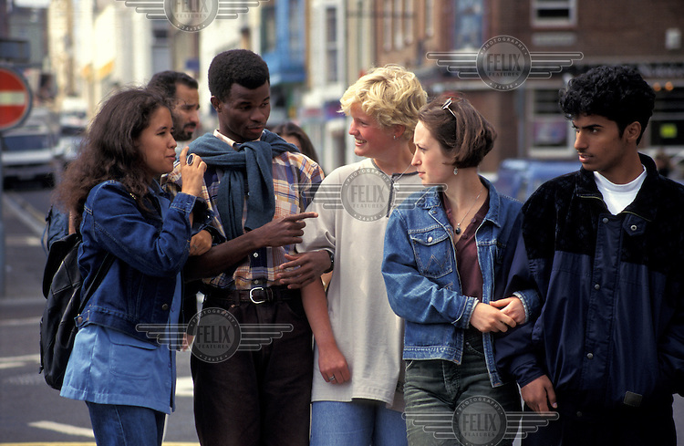 Racially-diverse group of teenagers.