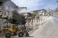 Bulldozer at a gravel quarry.