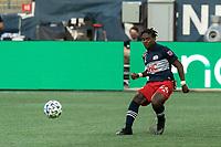 FOXBOROUGH, MA - SEPTEMBER 23: DeJuan Jones #24 of New England Revolution passes the ball during a game between Montreal Impact and New England Revolution at Gillette Stadium on September 23, 2020 in Foxborough, Massachusetts.