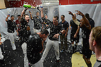 Rochester Red Wings pitcher Aaron Thompson and outfielders Brian Dinkelman, Dan Rohlfing, Antoan Richardson celebrate in the locker room after defeating the Scranton Wilkes Barre RailRiders on September 2, 2013 at Frontier Field in Rochester, New York to clinch the International League Wild Card Playoff spot.  (Mike Janes/Four Seam Images)