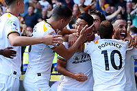 11th September 2021; Vicarge Road, Watford, Herts,  England;  Premier League football, Watford versus Wolverhampton Wanderers; Hwang Hee-chan of Wolverhampton Wanderers celebrates with team mates after he scores for 0-2 in the 83rd minute
