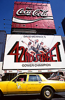 File Photo , New York , (NY) USA<br /> <br /> <br /> A yellow cab pass in front of a Coca Cola neon sign and 42nd Street (theater play) biillboard in new York City's Time Square<br /> (c) by Pierre Roussel / IMAGES DISTRIBUTION