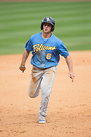 Mark Zagunis (6) of the Myrtle Beach Pelicans hustles towards third base against the Winston-Salem Dash at BB&T Ballpark on May 10, 2015 in Winston-Salem, North Carolina.  The Pelicans defeated the Dash 4-3.  (Brian Westerholt/Four Seam Images)