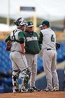 Fort Wayne TinCaps pitching coach Burt Hooton (center) talks with catcher Jose Ruiz (21) and pitcher T.J. Weir (6) during a game against the Lake County Captains on May 20, 2015 at Classic Park in Eastlake, Ohio.  Lake County defeated Fort Wayne 4-3.  (Mike Janes/Four Seam Images)