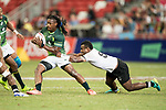 Jerry Tuwai of Fiji tries to tackle Branco Du Preez of South Africa who runs with the ball during the match Fiji vs South Africa, Day 2 of the HSBC Singapore Rugby Sevens as part of the World Rugby HSBC World Rugby Sevens Series 2016-17 at the National Stadium on 16 April 2017 in Singapore. Photo by Victor Fraile / Power Sport Images