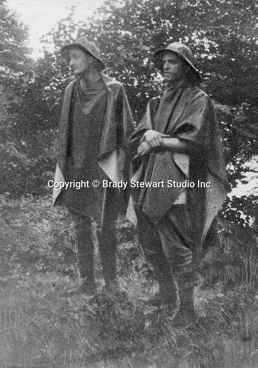 North East PA: Brady and Clark Stewart waiting out the rain in their new rain gear during a camping trip to Lake Erie.  Brady and Clark were the best of friends along with being brothers. During the early 1900s, the Stewart family vacationed on Lake Erie near North East Pennsylvania. Since hotels and motels were non-existent, camping was the only viable option for a large number of vacationers