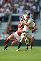 Joe Launchbury of England is tackled by Jamie Roberts of Wales during the Old Mutual Wealth Cup match between England and Wales at Twickenham Stadium on Sunday 29th May 2016 (Photo: Rob Munro/Stewart Communications)