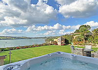 BNPS.co.uk (01202) 558833. <br /> Pic: LillicrapChilcott/BNPS<br /> <br /> Pictured: Hot tub in the garden. <br /> <br /> An impressive waterfront home with panoramic views over one of Britain's most popular estuaries is on the market for £2.75m.<br /> <br /> Tregytreath is the perfect property for boat lovers, with access to the foreshore and its own private jetty onto the water.<br /> <br /> The five-bedroom house is in Restronguet Point, one of the most exclusive waterside locations in Cornwall, and this property has one of the most outstanding positions among those prestigious homes.<br /> <br /> The house was designed and built, by the current owners 20 years ago, to make the most of the beautiful views.