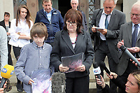 Pictured: Sonia Oatley (C) mother of tragic teen Rebecca Aylward with her young son Jack (L) reading a statement outside Swansea Crown Court. Friday 02 September 2011<br />