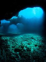 Light shines down into a collapsed undewater lava tube along the Waianae coast of O'ahu.