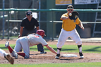 Ino Patron #4 of the Long Beach State Dirtbags catches a throw to first base during a game against the Indiana Hoosiers at Blair Field on March 15, 2014 in Long Beach, California. Indiana defeated Long Beach State 2-1. (Larry Goren/Four Seam Images)