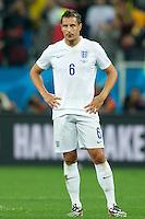 Phil Jagielka of England looks dejected