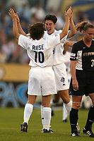 Hege Riise celebrates Birgit Prinz's first goal during the Carolina Courage's 3-2 victory over the New York Power on June 26th at Mitchel Athletic Complex.