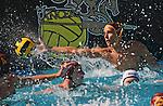 Waterpolo action photography. La Serna High School goalie blocks shot