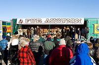 Spectators bid on furs at the Fur Auction.