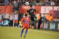 EAST RUTHERFORD, NJ - SEPTEMBER 7: Jesus Gallardo #23 of Mexico heads the ball against Reggie Cannon #20 of the United States during a game between Mexico and USMNT at MetLife Stadium on September 6, 2019 in East Rutherford, New Jersey.