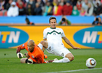 Zlatan Ljubijankic (right) of Slovenia scores the second goal past USA goalkeeper Tim Howard (left), 2-0. USA vs Slovenia in the 2010 FIFA World Cup at Ellis Park in Johannesburg, South Africa on June 18th, 2010.