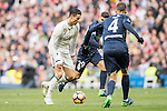 Cristiano Ronaldo (l) of Real Madrid competes for the ball with Luis Munoz (c) and Mikel Villanueva of Malaga CF during their La Liga 2016-17 match between Real Madrid and Malaga CF at the Estadio Santiago Bernabéu on 21 January 2017 in Madrid, Spain. Photo by Diego Gonzalez Souto / Power Sport Images