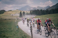 peloton over the gravel roads up the Montée du plateau des Glières (HC/1390m)<br /> <br /> Stage 10: Annecy > Le Grand-Bornand (159km)<br /> <br /> 105th Tour de France 2018<br /> ©kramon