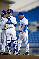 Dunedin Blue Jays pitching coach Mark Riggins (29) talks relief pitcher Jared Carkuff (19) and catcher Mike Reeves (7) during a game against the Clearwater Threshers on April 8, 2017 at Florida Auto Exchange Stadium in Dunedin, Florida.  Dunedin defeated Clearwater 12-6.  (Mike Janes/Four Seam Images)