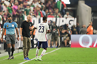 LAS VEGAS, NV - AUGUST 1: United States head coach Gregg Berhalter talks with Kellyn Acosta #23 during a game between Mexico and USMNT at Allegiant Stadium on August 1, 2021 in Las Vegas, Nevada.