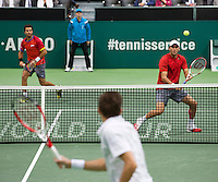 Rotterdam, The Netherlands. 16.02.2014. Nicolas Mahut(FRA) and Jean-Julien Rojer(NED)/Horia Tecau(ROE)  ABN AMRO World tennis Tournament<br /> Photo:Tennisimages/Henk Koster