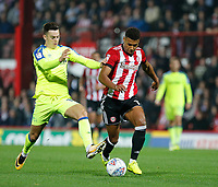Ollie Watkins of Brentford is tackled by Tom Lawrence of Derby County during the Sky Bet Championship match between Brentford and Derby County at Griffin Park, London, England on 26 September 2017. Photo by Carlton Myrie / PRiME Media Images.