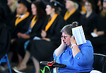 An unidentified woman talks on her cell phone in the front row during the 2013 Western Nevada College Commencement at the Pony Express Pavilion, in Carson City, Nev., on Monday, May 20, 2013. .Photo by Cathleen Allison