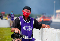 Jul 11, 2020; Clermont, Indiana, USA; NHRA photographer Roger Richards wears a red MAGA face mask during qualifying for the E3 Spark Plugs Nationals at Lucas Oil Raceway. This is the first race back for NHRA since the start of the COVID-19 global pandemic. Mandatory Credit: Mark J. Rebilas-USA TODAY Sports