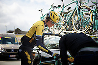Sep Vanmarcke (BEL/LottoNL-Jumbo) keeps his cool as the mechanic gets a new bike ready to continue the race. Vanmarcke is the very last rider as he rejoins the race and can start chasing to catch the peloton.<br /> <br /> 58th E3 Harelbeke 2015