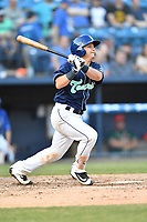 Asheville Tourists catcher Austin Bernard (2) swings at a pitch during a game against the Greensboro Grasshoppers  at McCormick Field on May 10, 2018 in Asheville, North Carolina. The Tourists defeated the Grasshoppers 9-3. (Tony Farlow/Four Seam Images)