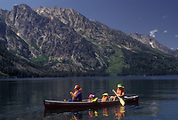 AJ3578, canoe, Grand Teton National Park, Lake Jenny, Grand Teton, Wyoming, Grand Teton Mountain, Rocky Mountains, A family paddles their canoe on Lake Jenny with a view of the majestic Teton Mountains behind in Grand Teton National Park in the state of Wyoming.