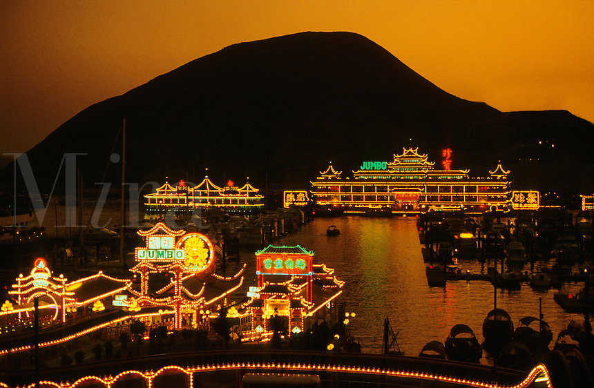 Hong Kong. Floating restaurants and harbour/harbor at Aberdeen. China. Evening..